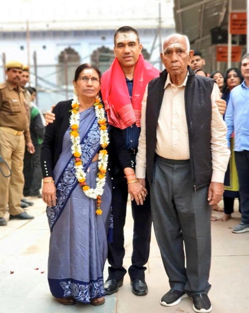 Navniet Sekera with mother and father.